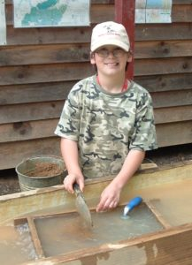A kid having fun at Rose Creek Gem Mine!